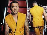 Fans slam Guy Sebastian as a 'fashion victim' for his sleeveless mustard suit on The Voice