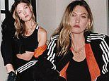 Karlie Kloss shows off her taut tummy and fit form while promoting Adidas
