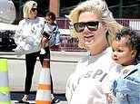 Khloe Kardashian models Kanye West's Holy Spirit sweatshirt with baby True in her arms