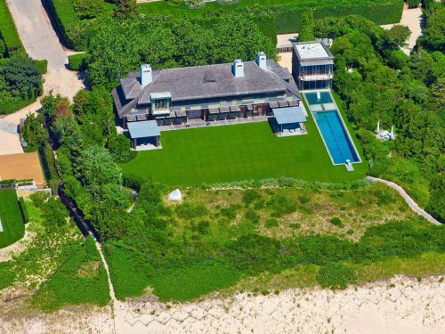 A hedge-fund manager finally unloaded his Hamptons mansion - for half of its asking price. Take a look inside the beachfront home