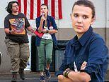 Millie Bobby Brown cuts a casual figure in cropped olive bottoms with a blue jacket while filming