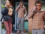 Dishevelled and barefoot Simon Baker, 53, grabs food with girlfriend Laura May Gibbs, 36
