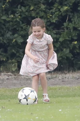 Princess Charlotte shows off her football skills during kickabout with Prince George at dad's polo match