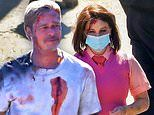 Brad Pitt sports fake blood and bruises as he films a crash scene with Joey King for Bullet Train