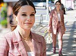 Sophia Bush looks like she means business as she heads to a lunch meeting in a chic pink plaid suit