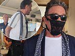 John McAfee claims he's been arrested in Norway for wearing lacy THONG on his face instead of mask