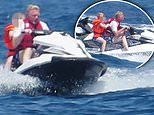 Boris Becker rides a jet ski with son Amadeus on sunny St Tropez getaway
