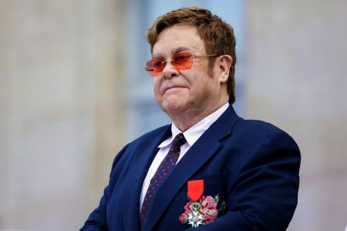 Elton John defends Meghan Markle and Prince Harry over private jet trip to south of France