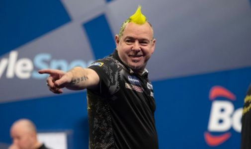 Peter Wright thrashes Rob Cross to ease into the Grand Slam quarter-finals