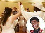 Lil Nas X crashes a wedding at Disney World as he steals a dance with the bride to Old Town Road