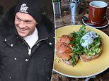 Breakfast of the champion! Tyson Fury kicks back at his local cafe in Morecambe