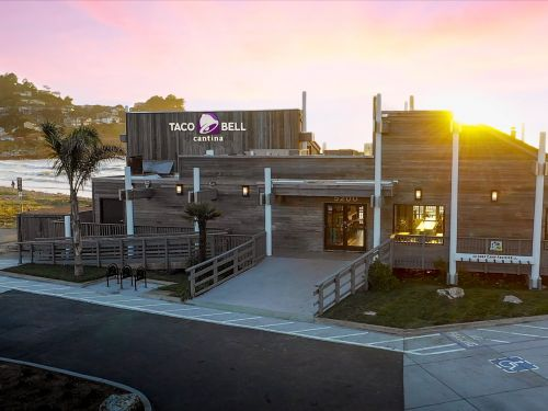 Taco Bell upgraded its iconic beachfront location with a fireplace, booze, and a surfboard parking section
