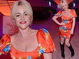 Jaime Winstone dons orange floral mini dress as she attends the De La Vali LFW show