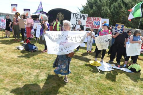 Video: More than 100 protesters at Donald Trump's north-east golf course