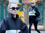 Elsa Hosk covers up in Balenciaga windbreaker while taking care of some shopping in NYC