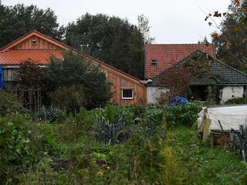 The owner of the Dutch farmhouse where a man and 5 young adults were found living in isolation said she had no idea they were there