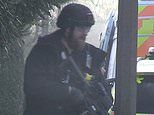 Armed police put school on lockdown as officers swoop on house nearby