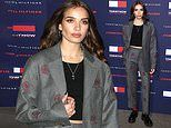 Hana Cross commands attention in chic grey trouser suit at Tommy Hilfiger's London Fashion Week show