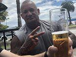 Dustin Martin's dad Shane knocks back a beer as he cheers on his son from a pub in New Zealand