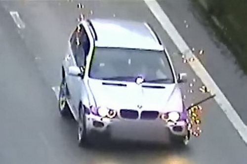 Sparks fly from BMW as drunk driver crashes on motorway with just two wheels