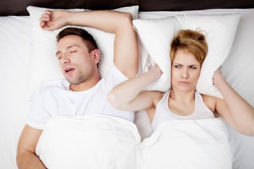 Sleeping next to someone who snores can be really bad for your health, study finds