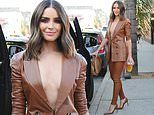 Olivia Culpo goes braless in leather power suit around LA