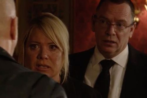 EastEnders' Phil kisses Sharon after she tries to stab him at Dennis' wake