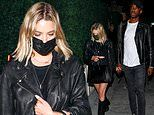 Ashley Benson holds hands with a mystery man during night out in Los Angeles
