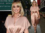 Rhian Sugden flaunts her curves in a blush pink satin jumpsuit as she attends nightclub launch