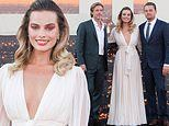Margot Robbie goes old Hollywood glamour in plunging white gown alongside her costars