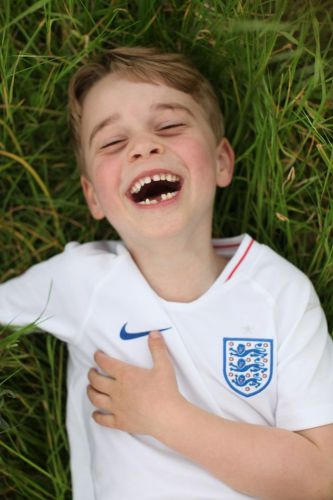 Adorable pictures show Prince George beaming in England strip as he turns six