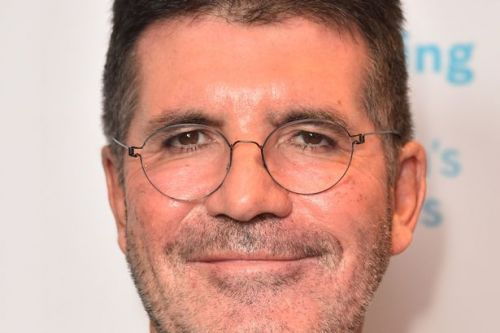 Simon Cowell 'breaking vegan diet to pile on weight' in recovery for broken back
