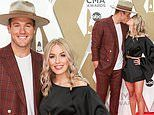 The Bachelor's Colton Underwood and Cassie Randolph kiss on star-studded CMA Awards red carpet