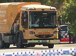 Garbage truck driver is charged after an elderly woman is run over and killed in Sydney's west