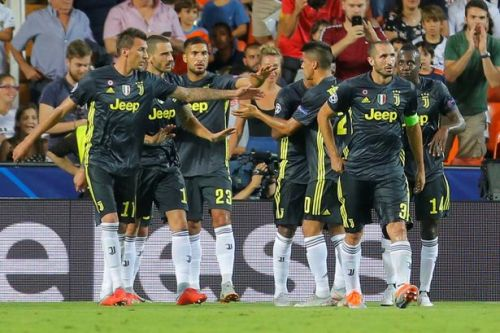 Valencia 0-2 Juventus REPORT: Cristiano Ronaldo sent off but Miralem Pjanic scores double from penalty spot