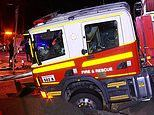 Fire engine is stranded in the middle of the road for hours after a sinkhole suddenly opens