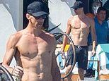 Michael Phelps shows off chiseled physique as he goes shirtless by the pool in Cabo