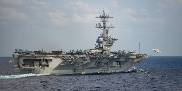 The US Navy is trying to get sailors off the aircraft carrier hit by a coronavirus outbreak, but it is having trouble finding enough beds