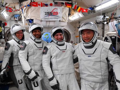 Station astronauts prep for relocation of SpaceX crew capsule