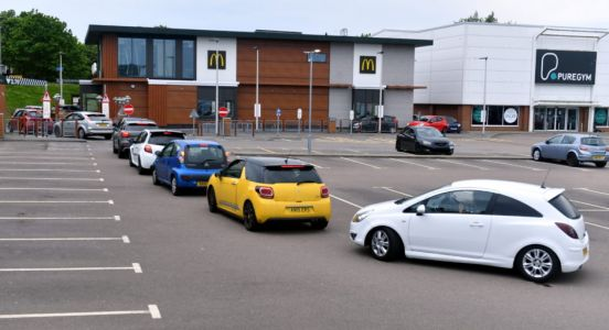 VIDEO: Fast food fans queue outside north and north-east McDonald's branches as they open for first time in months