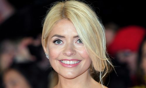 Holly Willoughby looks bashful after she's caught swearing on This Morning - video
