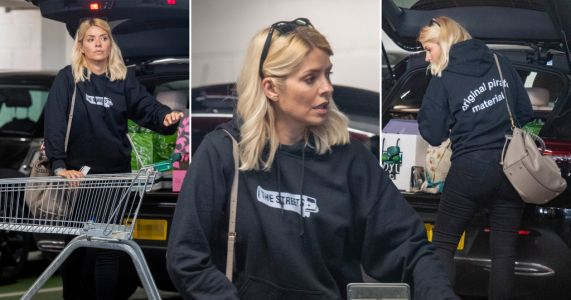 Holly Willoughby supports pal Mike Skinner as she rocks The Streets hoodie for big shop