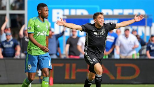 Russell's hat trick carries SKC past Sounders