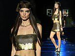 Emily Ratajkowski shows her taut midriff in shimmering gold top at Versace special event in Milan