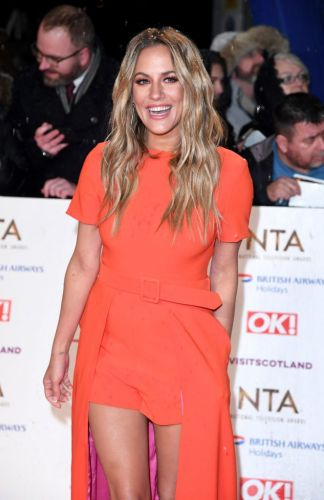 Caroline Flack gets Andrew Brady tattoo tribute 'removed' ahead of return to the red carpet at NTAs