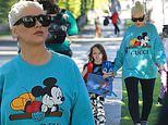 Christina Aguilera sports a Gucci Disney sweatshirt as she picks up daughter Summer Rain from school