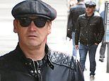 Sid Owen cuts a sombre figure as he steps out after losing six teeth and shattering his jaw