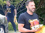 Ben Affleck smiles as he gets breakfast delivered from Dunkin' Donuts during quarantine