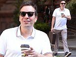 Jimmy Fallon celebrates his 44th birthday with a morning stroll while carrying his loved briefcase