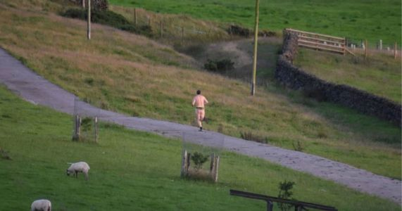 Nude man goes running in just a bumbag and trainers